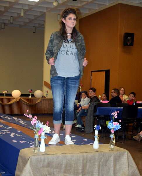 A Northeastern Junior College student models jeans, a t-shirt and a jacket from Maurices at the NJC Cosmetology Fashion Show Fundraiser Saturday, Feb. 25,  2017.