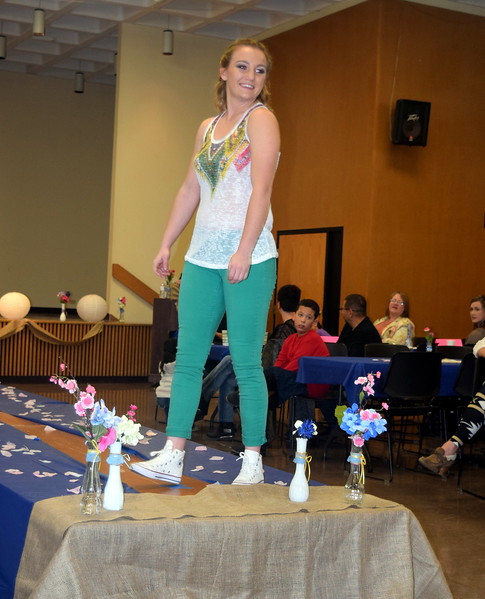 A Northeastern Junior College student models pants and a top from Clothes Line at the NJC Cosmetology Fashion Show Fundraiser Saturday, Feb. 25,  2017.
