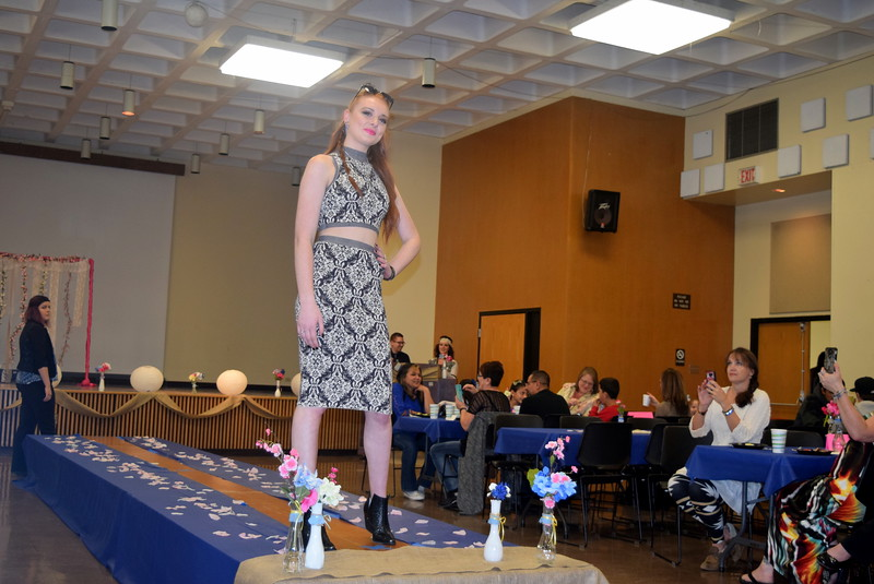 A Northeastern Junior College student models a skirt and top from the Buckle at the NJC Cosmetology Fashion Show Fundraiser Saturday, Feb. 25,  2017.
