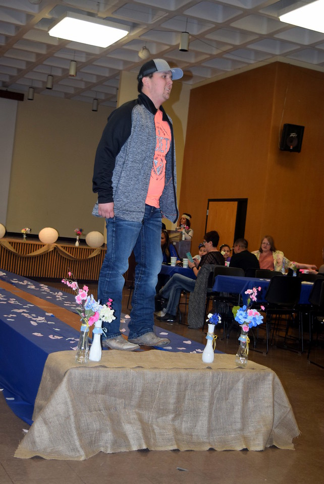 A Northeastern Junior College student modles jeans, a t-shirt and jack from the Buckle at the NJC Cosmetology Fashion Show Fundraiser Saturday, Feb. 25,  2017.