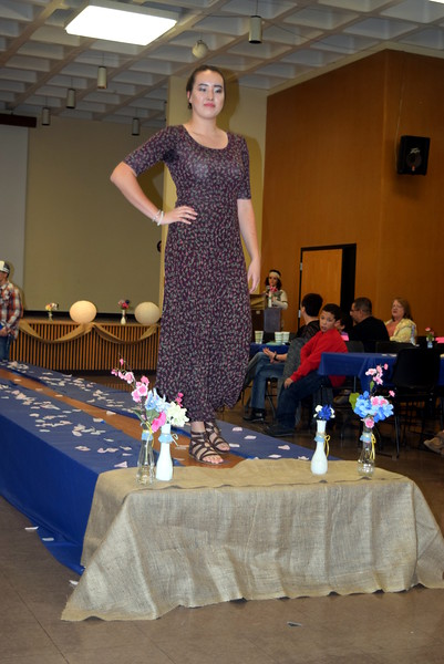 Katie Saunders models shorts a dress from LuLaRoe at NJC Costmetology's Fashion Show Fundraiser Saturday, Feb. 25, 2017.