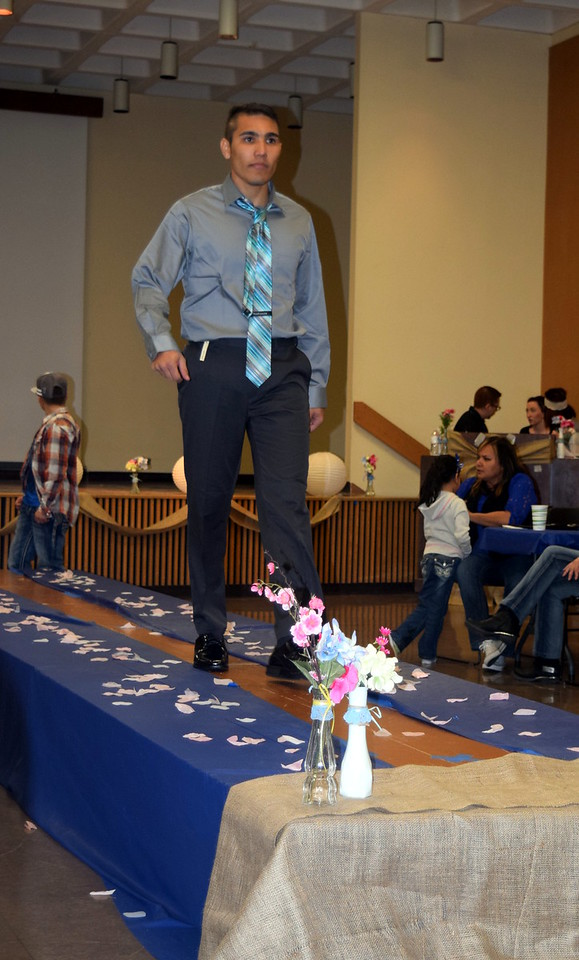 Paul Liagre models dress paints, dress shirt and tie from Bealls at the NJC Cosmetology Fashion Show Fundraiser Saturday, Feb. 25, 2017.