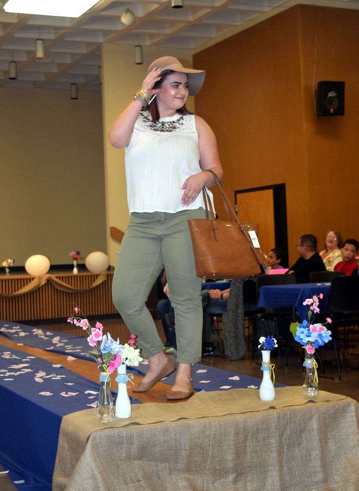 A Northeastern Junior College student models pants, a top, a purse and a hat from Bealls at the NJC Cosmetology Fashion Show Fundraiser Saturday, Feb. 25,  2017.