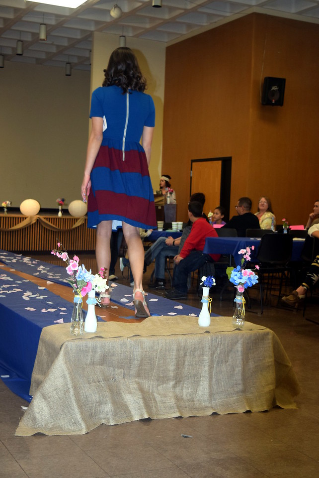 A Northeastern Junior College student models a dress from LuLaRoe at the NJC Cosmetology Fashion Show Fundraiser Saturday, Feb. 25,  2017.