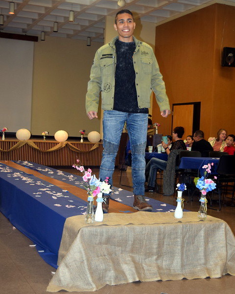 A Northeastern Junior College student models jeans, a t-shirt and jack from Buckle at the NJC Cosmetology Fashion Show Fundraiser Saturday, Feb. 25, 2017.