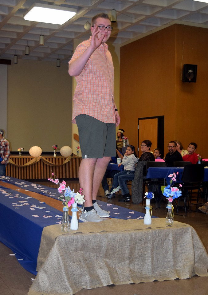 Gavin Fitzgerald models shorts and a shirt from the Bealls at the NJC Cosmetology Fashion Show Fundraiser Saturday, Feb. 25,  2017.