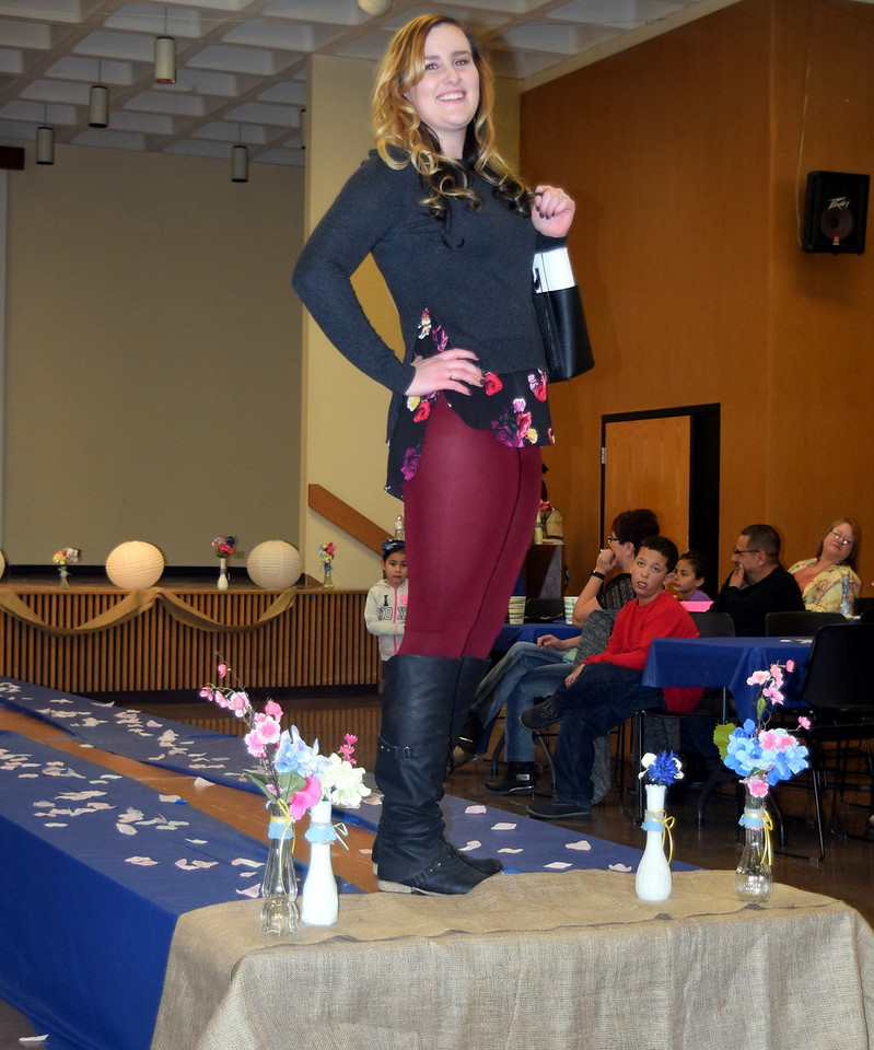 A model walks the runway in an outfit from Clothes Line at the NJC Costmetology Fashion Show Fundraiser Saturday, Feb. 25, 2017.