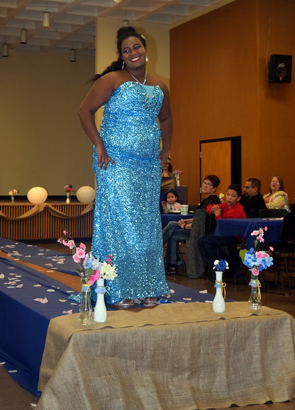 Feven Bedard-Khalid models a formal dress from Enchanted Dreams at the NJC Cosmetology Fashion Show Fundraiser Saturday, Feb. 25, 2017.