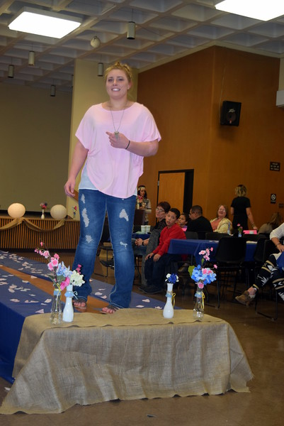 A Northeastern Junior College student models an outfit from Barb's Gifts at the NJC Cosmetology Fashion Show Fundraiser Saturday, Feb. 25,  2017.
