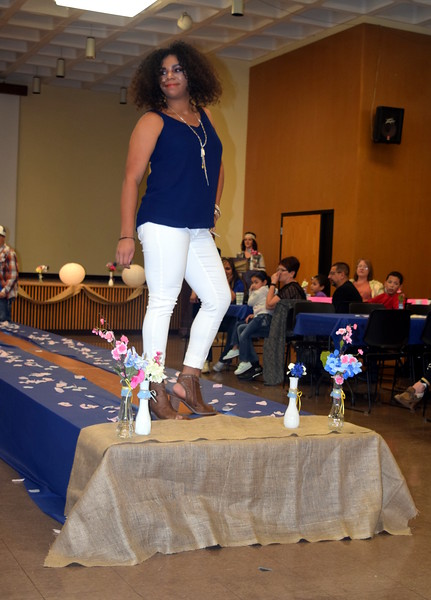 Simone Marcus models boots, pants and a top from Maurices at the NJC Cosmetology Fashio Show Fundraiser Saturday, Feb. 25, 2017.