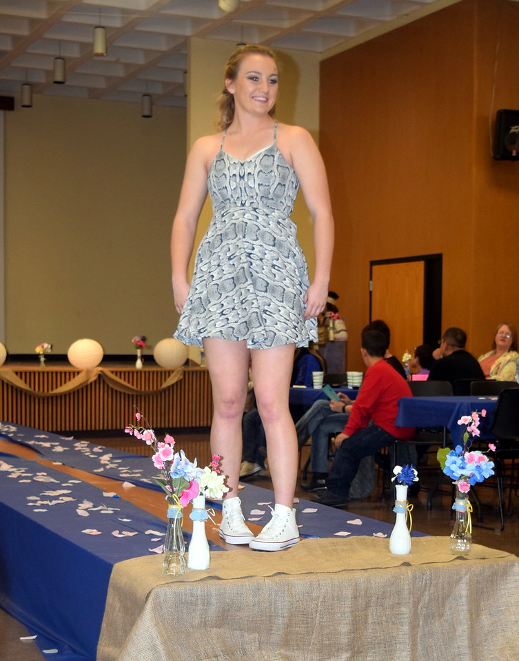 A Northeastern Junior College student models a dress from Clothes Line at the NJC Cosmetology Fashion Show Fundraiser Saturday, Feb. 25,  2017.