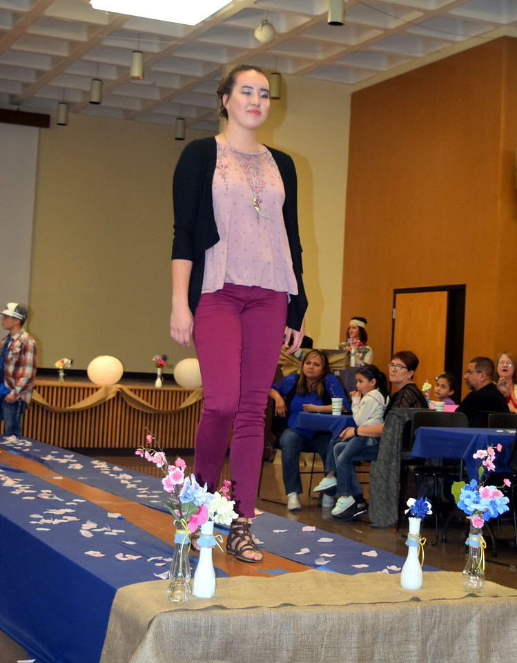 Katie Saunders models pants, a top and sweater from Maurices at NJC Costmetology's Fashion Show Fundraiser Saturday, Feb. 25, 2017.