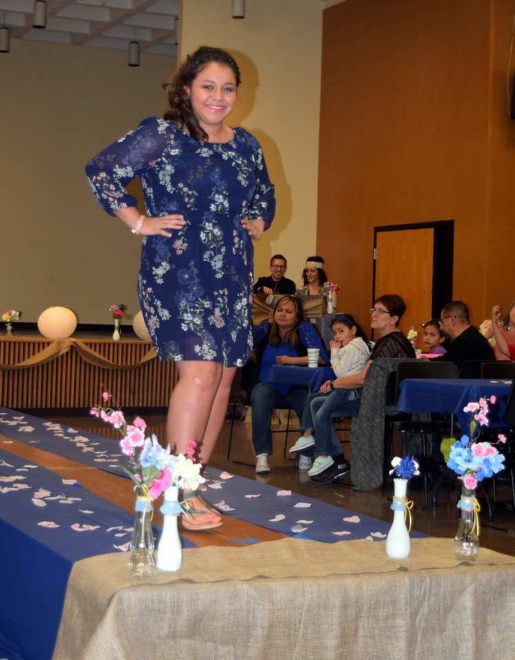A Northeastern Junior College students models a dress from Maurices at the NJC Cosmetology Fashion Show Fundraiser Saturday, Feb. 25,  2017.
