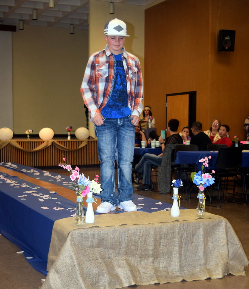 A youngster models jeans, a t-shirt and overshirt from the Buckle at the NJC Cosmetology Fashion Show Fundraiser Saturday, Feb. 25,  2017.