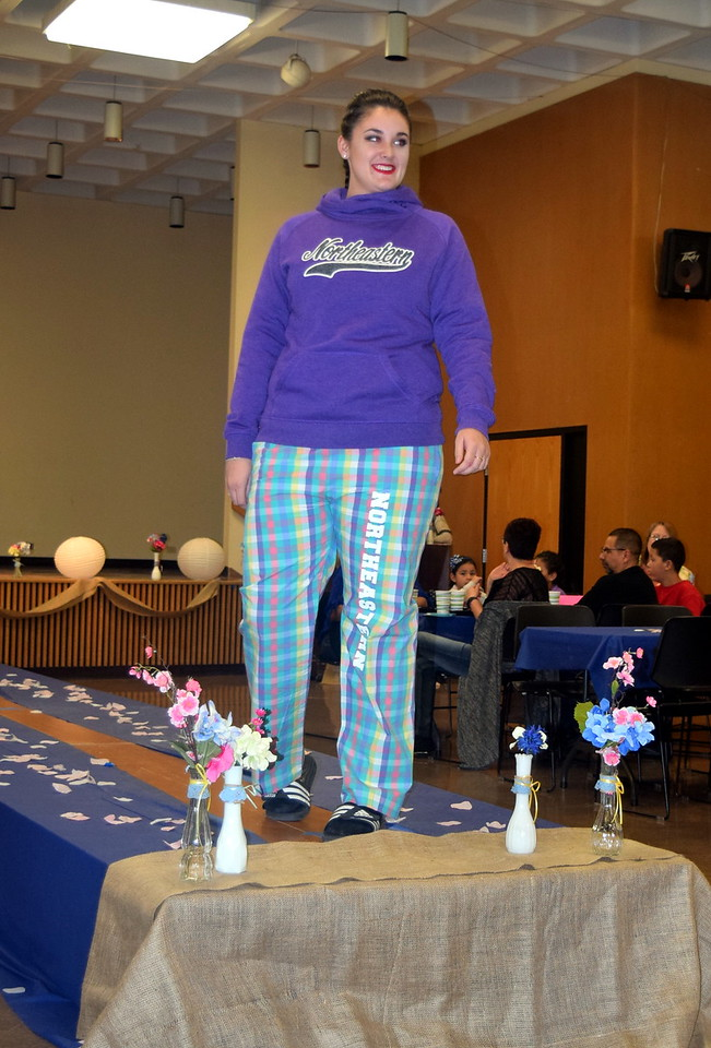Jordan Will models a sweatshirt and pajama pants from NJC Bookstore at the NJC Cosmetology Fashion Show Fundraiser Saturday, Feb. 25,  2017.