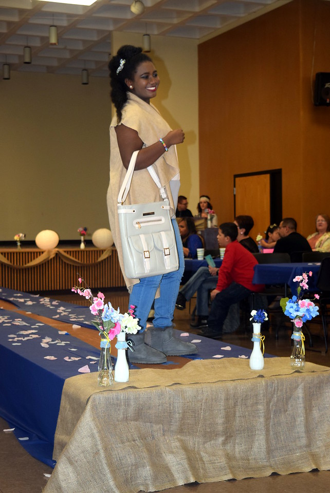 Feven Bedard-Khalid models an outfit from Barb's Gifts at the NJC Cosmetology Fashion Show Fundraiser Saturday, Feb. 25, 2017.