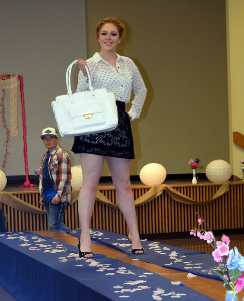 A Northeastern Junior College student models a top, skirt and purse from Clothes Line at the NJC Cosmetology Fashion Show Fundraiser Saturday, Feb. 25,  2017.
