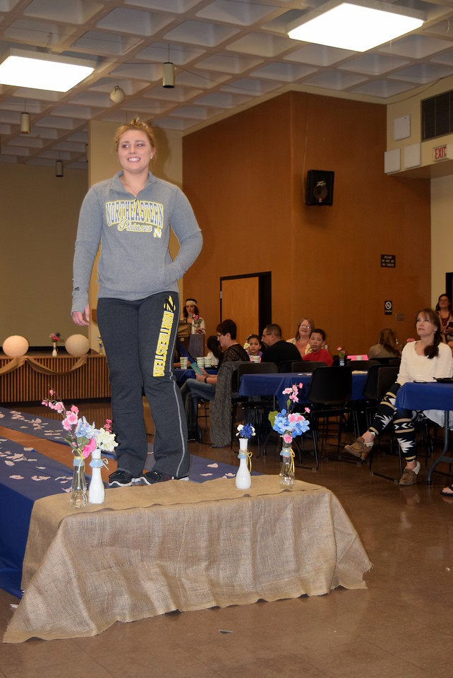 A Northeastern Junior College student models sweatpants and a sweatshirt from the NJC Bookstore at the NJC Cosmetology Fashion Show Fundraiser Saturday, Feb. 25,  2017.