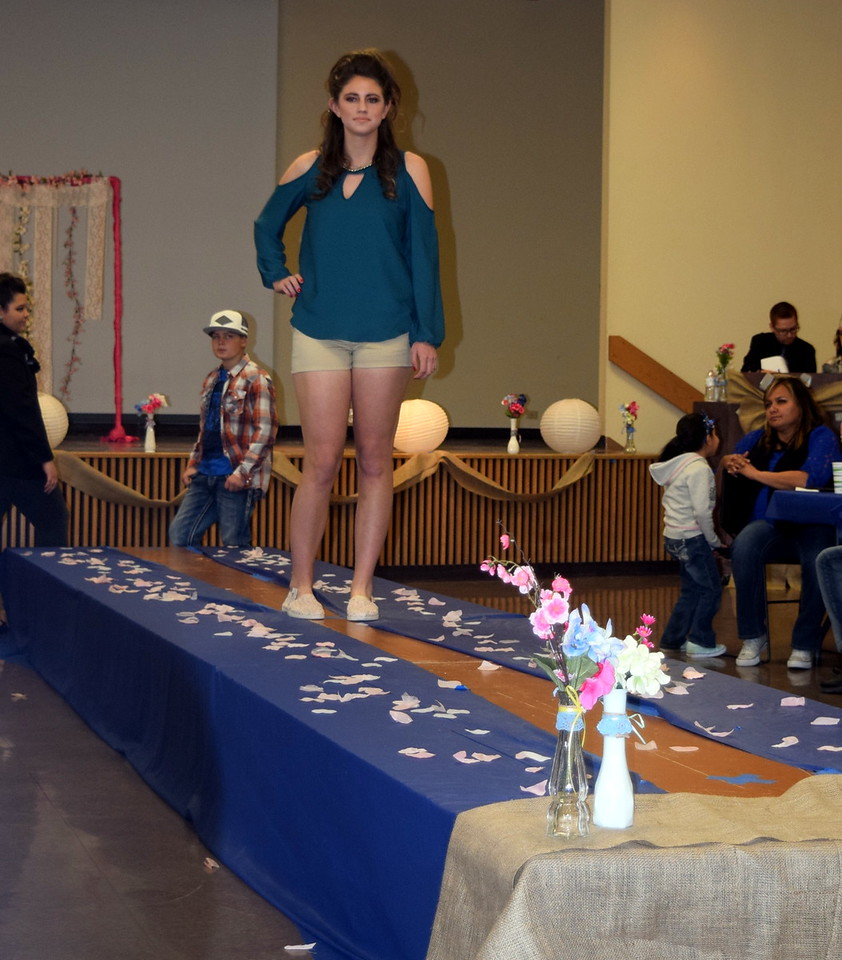 A Northeastern Junior College student models shorts and a top from Bealls at the NJC Cosmetology Fashion Show Fundraiser Saturday, Feb. 25,  2017.