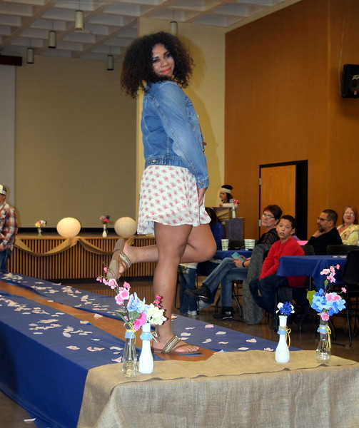 Simone Marcus models a jacket and dress from Clothes Line at the NJC Cosmetology Fashio Show Fundraiser Saturday, Feb. 25, 2017.