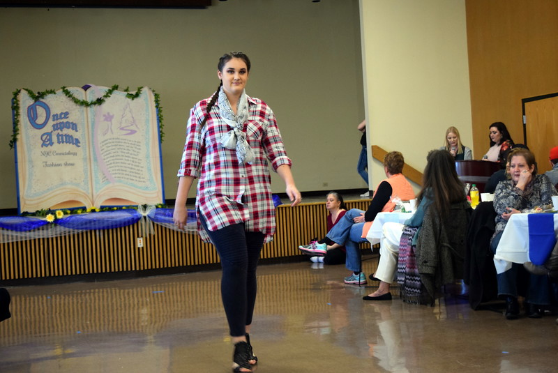 "A Northeastern Junior College student models an outfit from Ella J's at NJC cosmetology's ""Once Upon a Time"" fashion show fundraiser Saturday, Feb. 24, 2018."