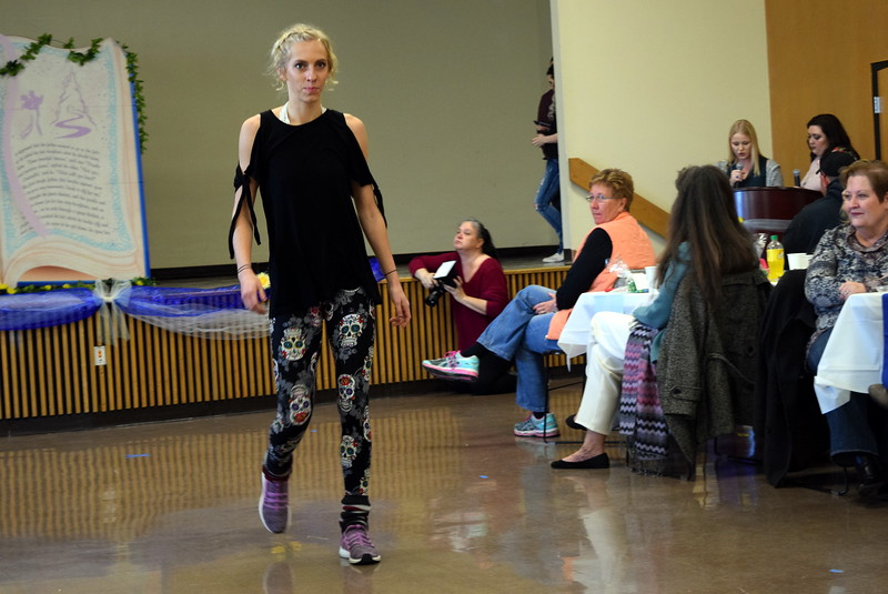 "A Northeastern Junior College student models an outfit from Legging Depot/Denise's Delight at the NJC cosmetology ""Once Upon a Time"" fashion show fundraiser Saturday, Feb. 24, 2018."
