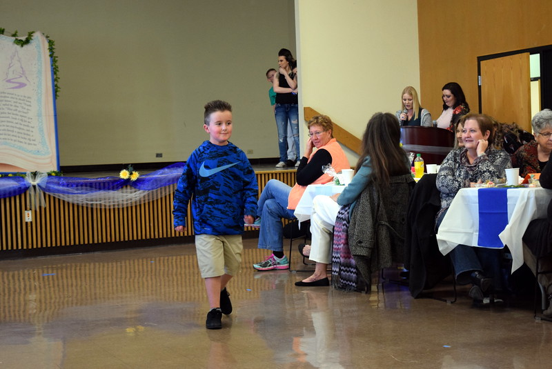 "A youngster models an outfit from Bealls at the NJC cosmetology ""Once Upon a Time"" fashion show fundraiser Saturday, Feb. 24, 2018."