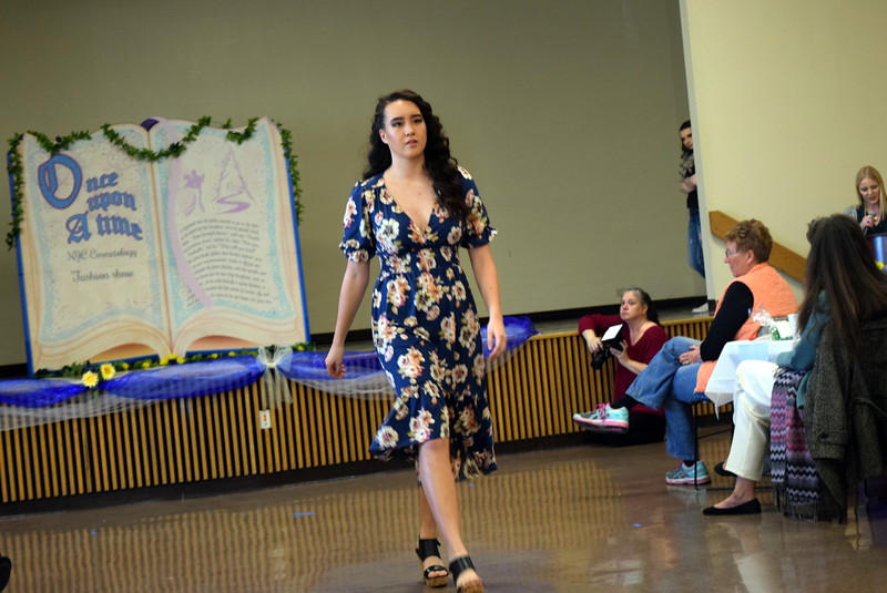 "A Northeastern Junior College student models an outfit from Ella J's at the NJC cosmetology ""Once Upon a Time"" fashion show fundraiser Saturday, Feb. 24, 2018."
