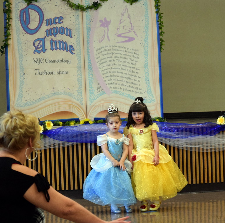 "Two youngsters kick off Northeastern Junior College cosmetology's ""Once Upon a Time"" fashion show Saturday, Feb. 24, 2018, dressed in Cinderella and Belle princess dresses."