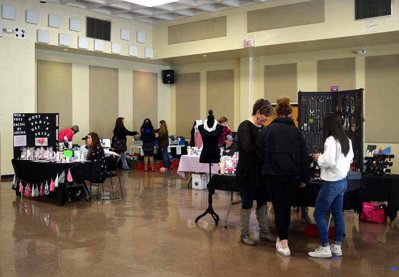 "Guests look over a variety of vendor booths at Northeastern Junior College cosmetology's ""Once Upon a Time"" fashion show Saturday, Feb. 24, 2018."