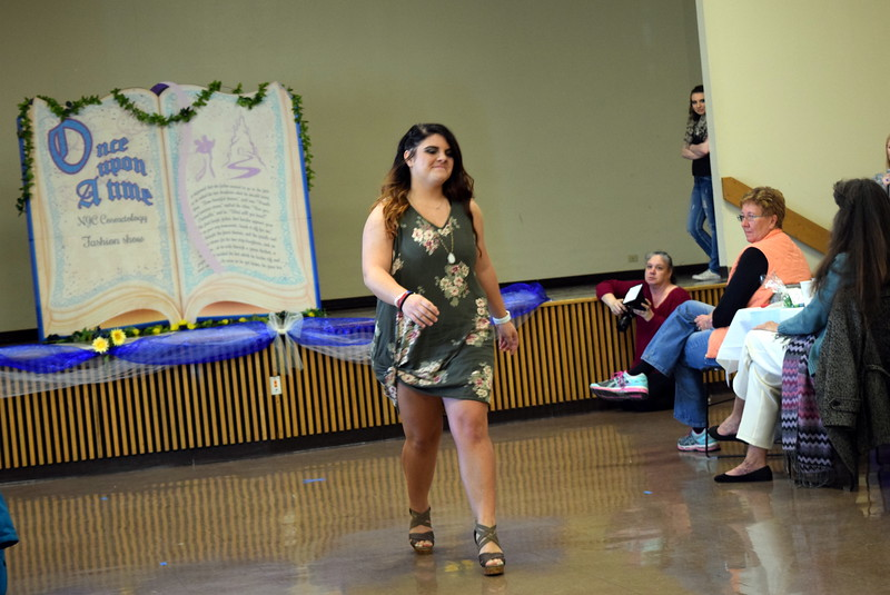 "A Northeastern Junior College student models an outfit from Maurice's at the NJC cosmetology ""Once Upon a Time"" fashion show fundraiser Saturday, Feb. 24, 2018."