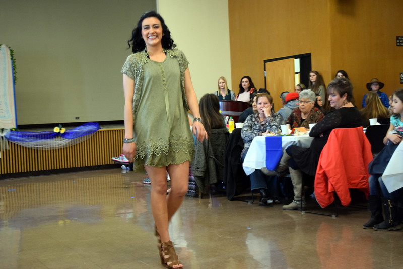 "A Northeastern Junior College student models an outfit from Flower Petaler at the NJC cosmetology ""Once Upon a Time"" fashion show fundraiser Saturday, Feb. 24, 2018."