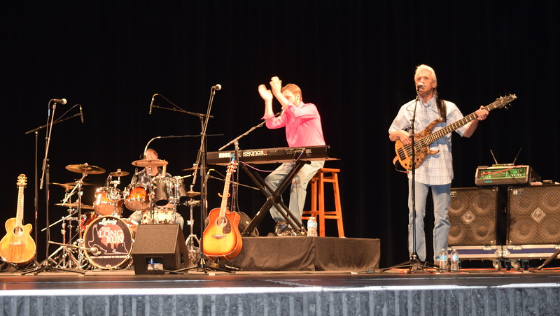 Members of the Eagles tribute band The Long Run perform during a concert at the E.S. French grand re-opening celebration Saturday, April 2, 2016.