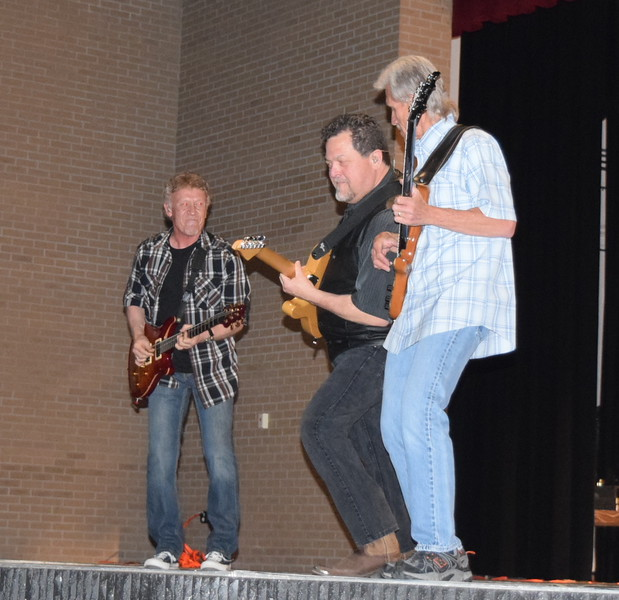 Members of the Eagles tribute band The Long Run jam out during a concert at the E.S. French grand re-opening celebration Saturday, April 2, 2016.