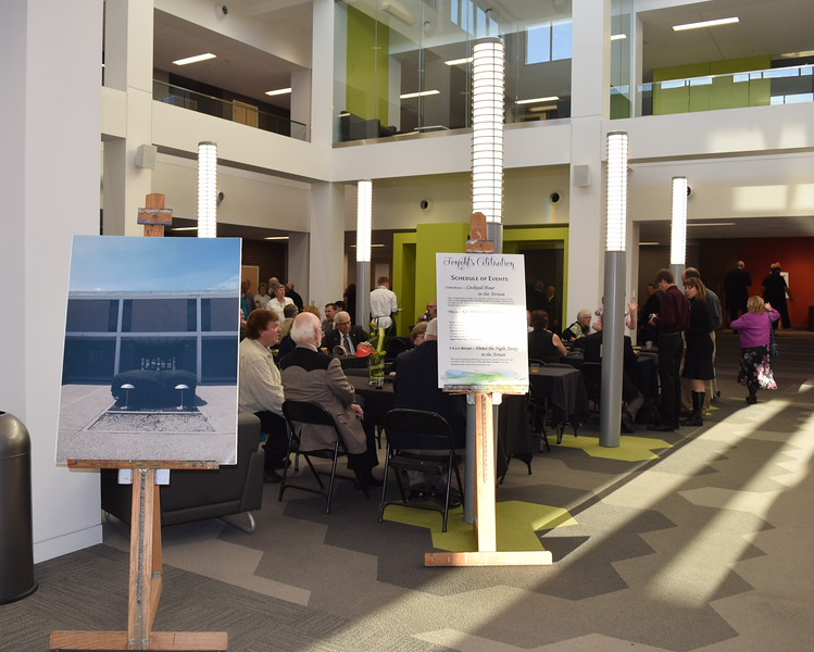 A photo showing E.S. French's courtyard before the renovation greeted guests at they entered the now enclosed atrium to enjoy cocktails and hors d'oeuvres during NJC's grand re-opening celebration for the building Saturday, April 2, 2016.
