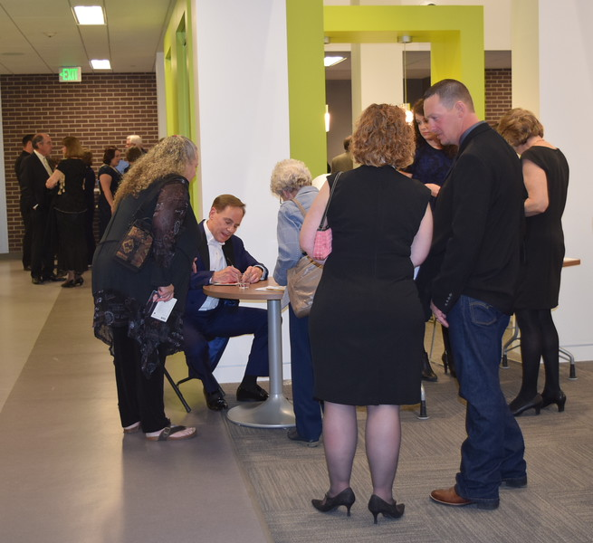 International piano star Richard Steinbach signs copies of his newest CD following his performance at the E.S. French grand re-opening celebration Saturday, April 2, 2016.