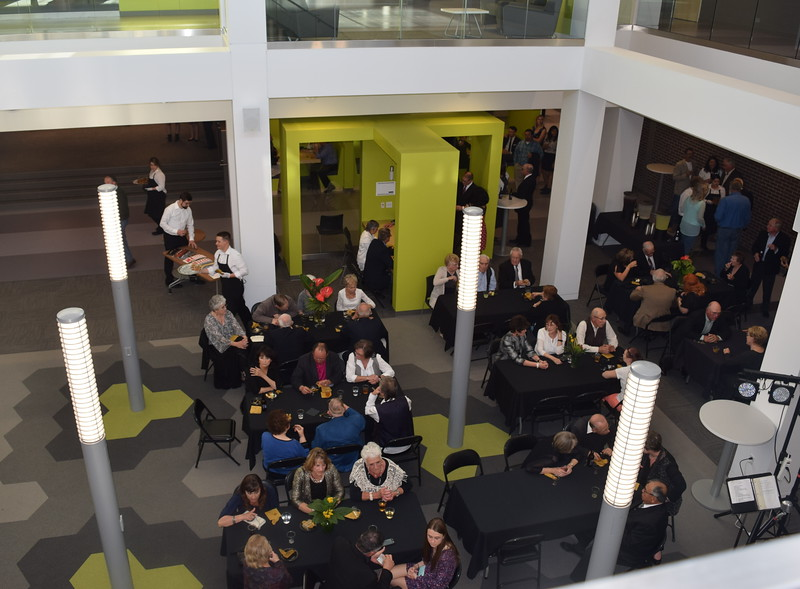 Guests enjoy cocktails and and hors d'oeuvres in the atrium of the newly renovated E.S. French Hall during NJC's grand re-opening celebration Saturday, April 2, 2016.