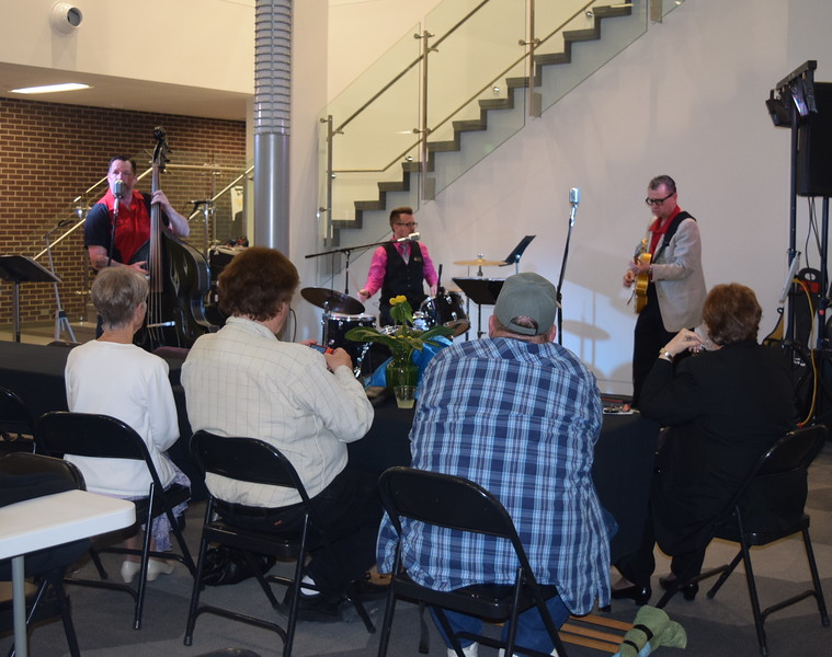 Guests enjoy the music of the Juke Joint Cruisers at the close of the E.S. French grand re-opening celebration Saturday, April 2, 2016.