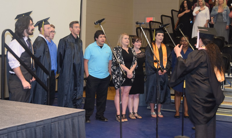 The Northeastern Junior College Contemporary Choir performs the National Anthem, under the direction of Celeste Delgado-Pelton, at the start of the college's commencement Friday, May 12, 2017.