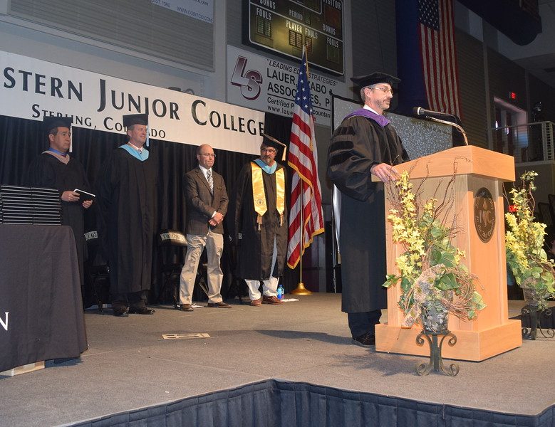 Northeastern Junior College President Jay Lee waits to give remarks at the opening of the college's commencement Friday, May 12, 2017. Behind him are, from left; Richard E. Martinez Jr., Colorado Community College System board member; John Chapdelaine, chair of the NJC Advisory Council; Brian Cunningham, president of the NJC Alumni Association; and Mark Thompson, chair of the liberal arts department.
