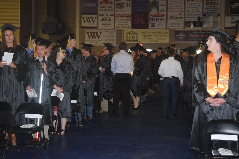 Graduates proceed into the gym at the start of Northeastern Junior College's commencement ceremony Friday, May 12, 2017.