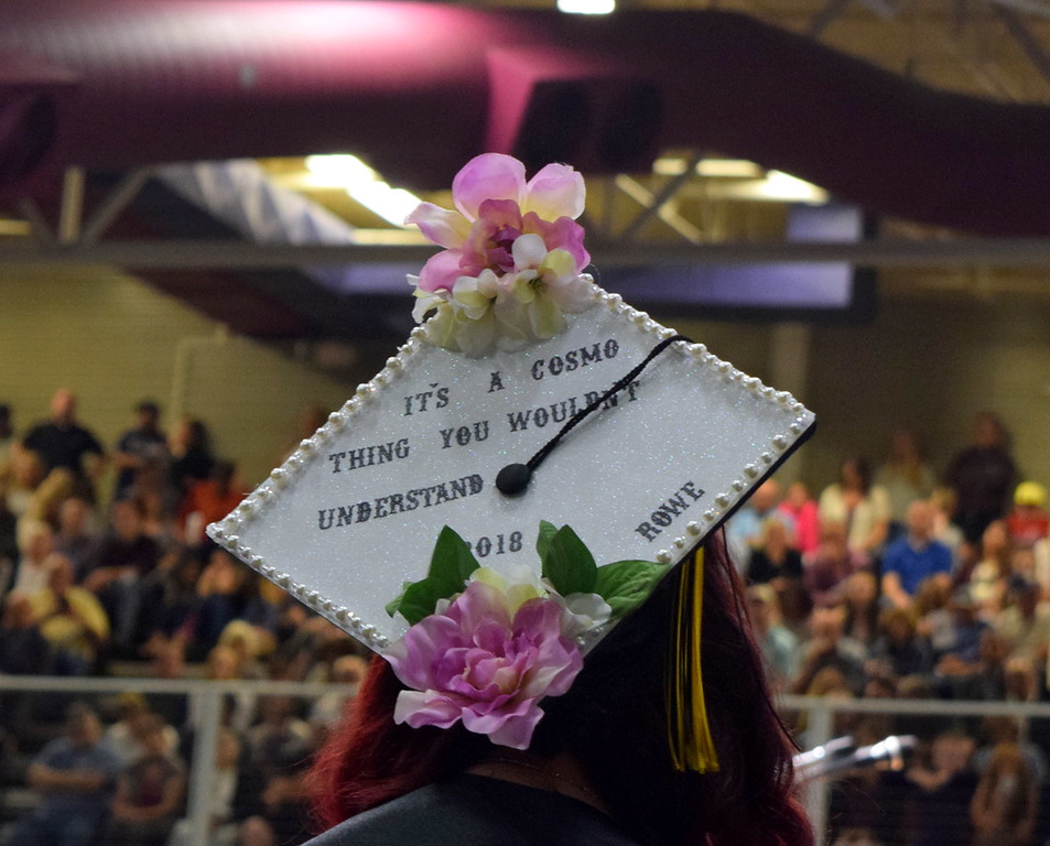 """It's a cosmo thing, you wouldn't understand"" reads the cap of one of the graduates at Northeastern Junior College's commencement ceremony Friday, May 11, 2018."