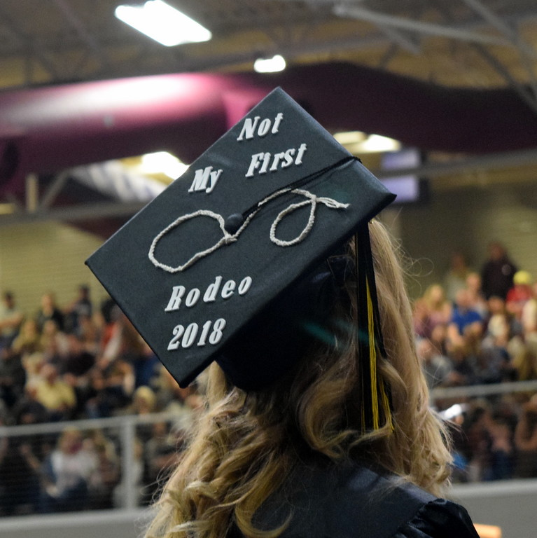 ". ""Not My First Rodeo\"" reads the cap of one of the graduates at Northeastern Junior College\'s commencement ceremony Friday, May 11, 2018."