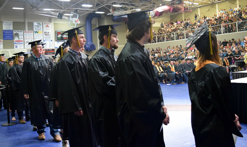 Graduates wait in line to get their degree and/or certificate at Northeaster Junior College's commencement ceremony Friday, May 11, 2018.