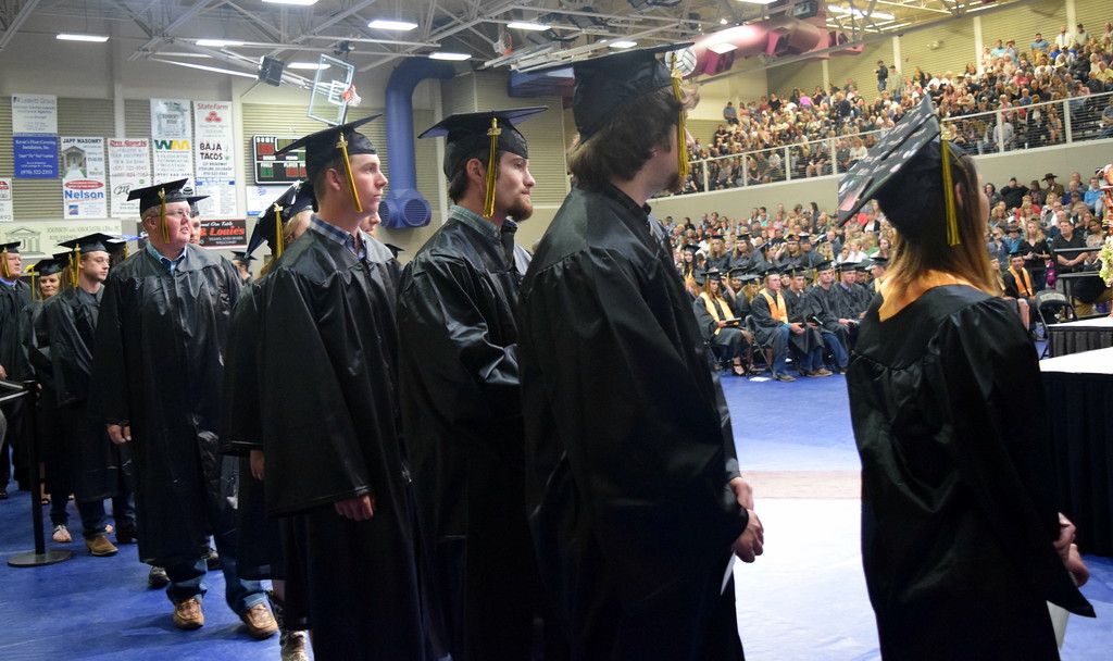 . Graduates wait in line to get their degree and/or certificate at Northeaster Junior College\'s commencement ceremony Friday, May 11, 2018.