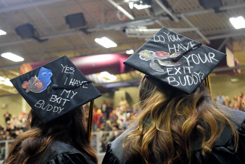 "Two Northeastern Junior College graduates wear ""Finding Nemo"" themed caps at the commencement ceremony Friday, May 11, 2018."