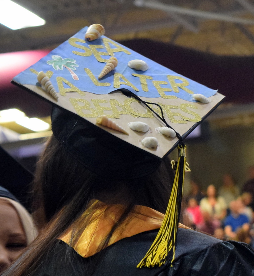 A graduate has their cap decorated in a sea theme at Northeastern Junior College's commencement ceremony Friday, May 11, 2018.