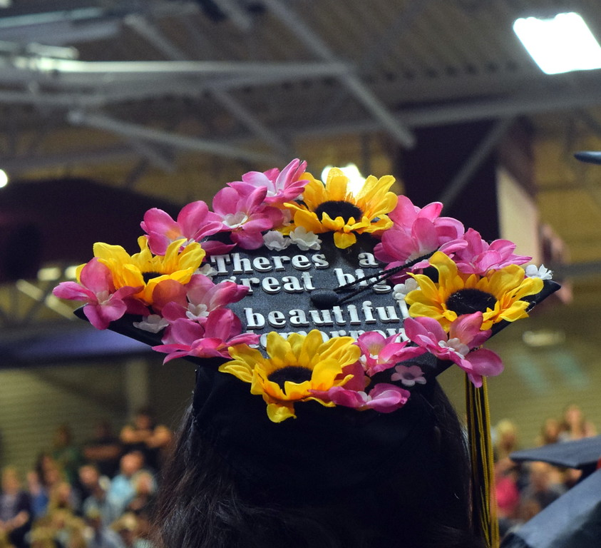 There's a great big beautiful tomorrow, reads one of the graduates' caps at Northeastern Junior College's commencement ceremony Friday, May, 11, 2018.