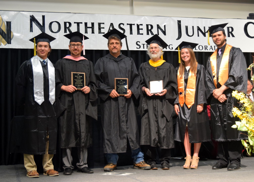 . Northeastern Junior College Associated Student Government officers Tyler Szymkowic, left, president, Megan Gerk and Ryan Kelso, right, present the Joel E. Mack Award to oustanding faculty members, from left; Lee Lippstrew, music instructor; Jimmy Atencio, diesel technology instructor; and David Coles, science professor, during the college\'s commencent ceremony Friday, May 11, 2018.