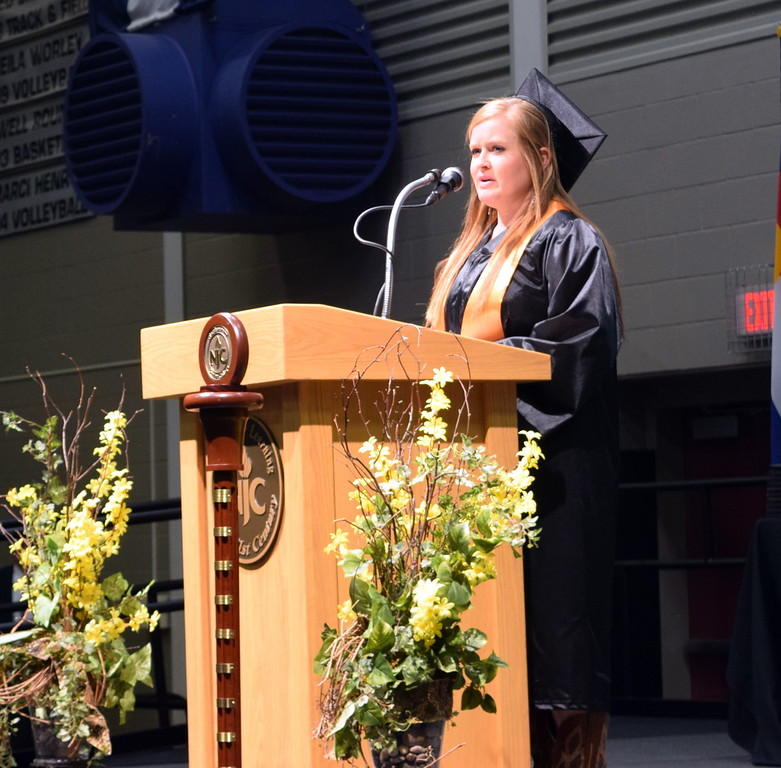Northeastern Junior College graduate Jordyn Holmes gives the invocation during the commencement ceremony Friday, May 11, 2018.